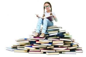 kid on book pile background 1024x682 1