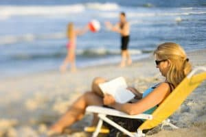 beach woman reading blurred 1024x682 1