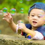 Baby Boy Playing with Bubbles 1280x853 1 1024x682 1