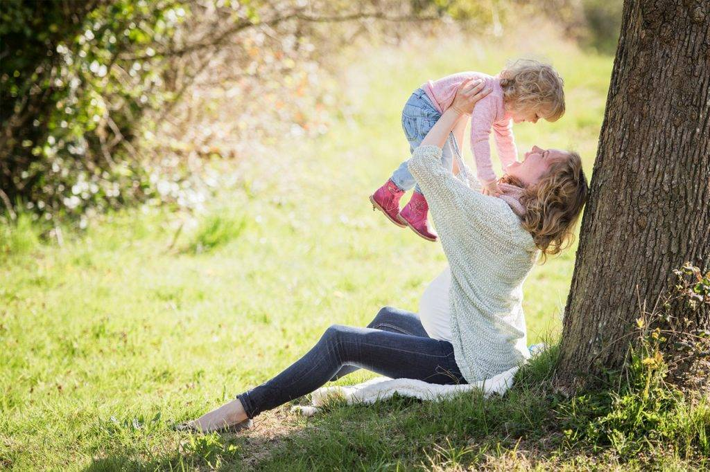 Mother-and-child-near-tree-1024x682-1