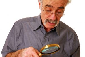 Senior Man Magnifying Glass 1024x682 1