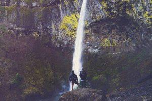 waterfall mountain two people 1024x682 1