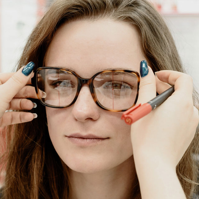 woman-trying-on-a-new-pair-of-glasses-640