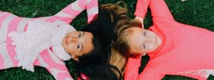 Young Girls Laying on Grass 1280x480 1024x384 1