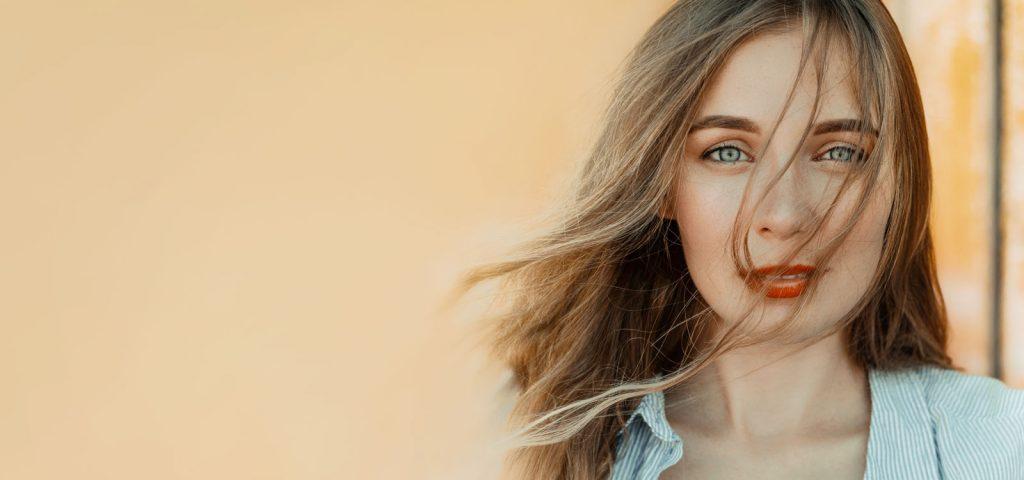 GrandPav-Woman-Blue-Eyes-Orange-Bkgrnd-1-1024x480-1