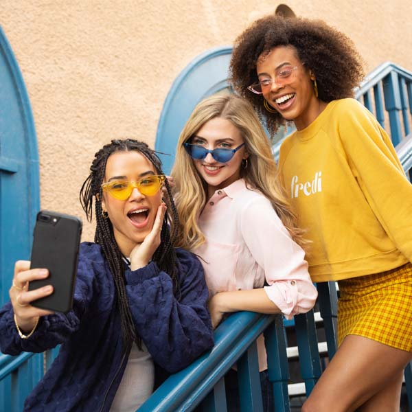 woman-friends-smiling-with-sunglasses