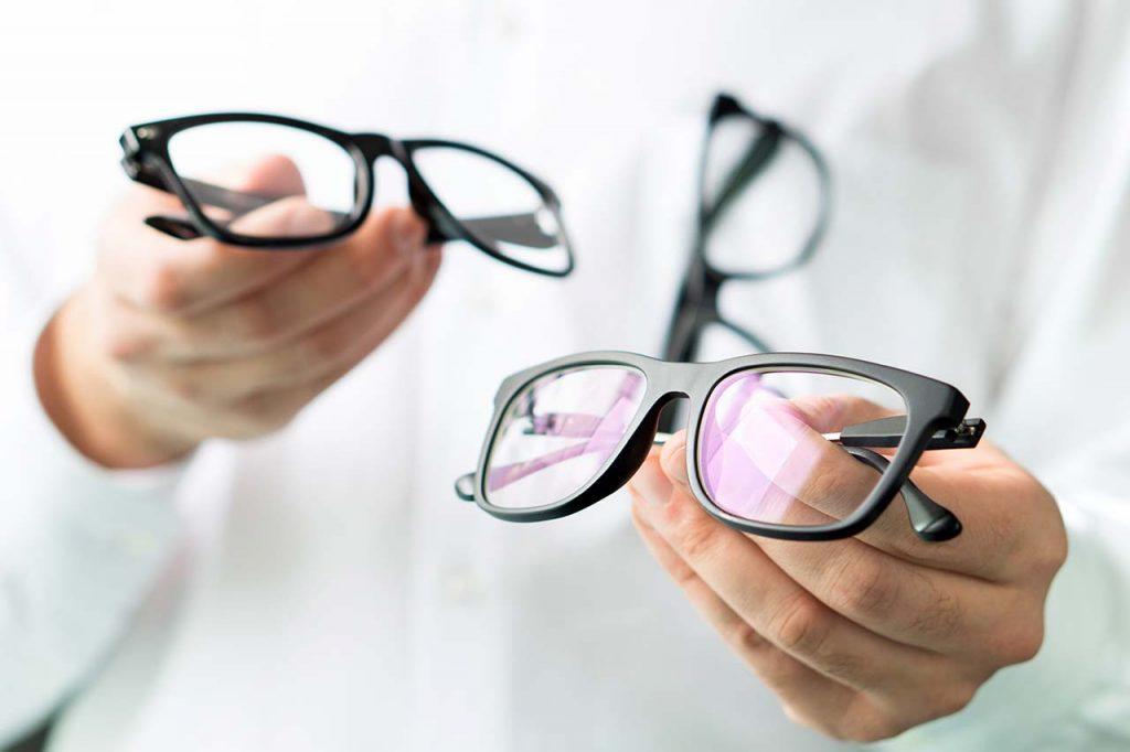 Optician-Holding-Glasses_1280x853-1024x682-1