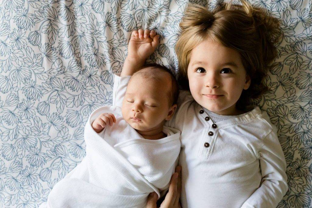 Toddler-and-Baby-on-Bed-1280x853-1024x682-1