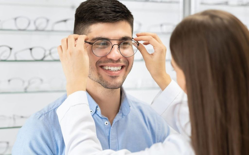 happy-man-trying-on-a-new-pair-of-eyeglasses-hero-1024x641-1
